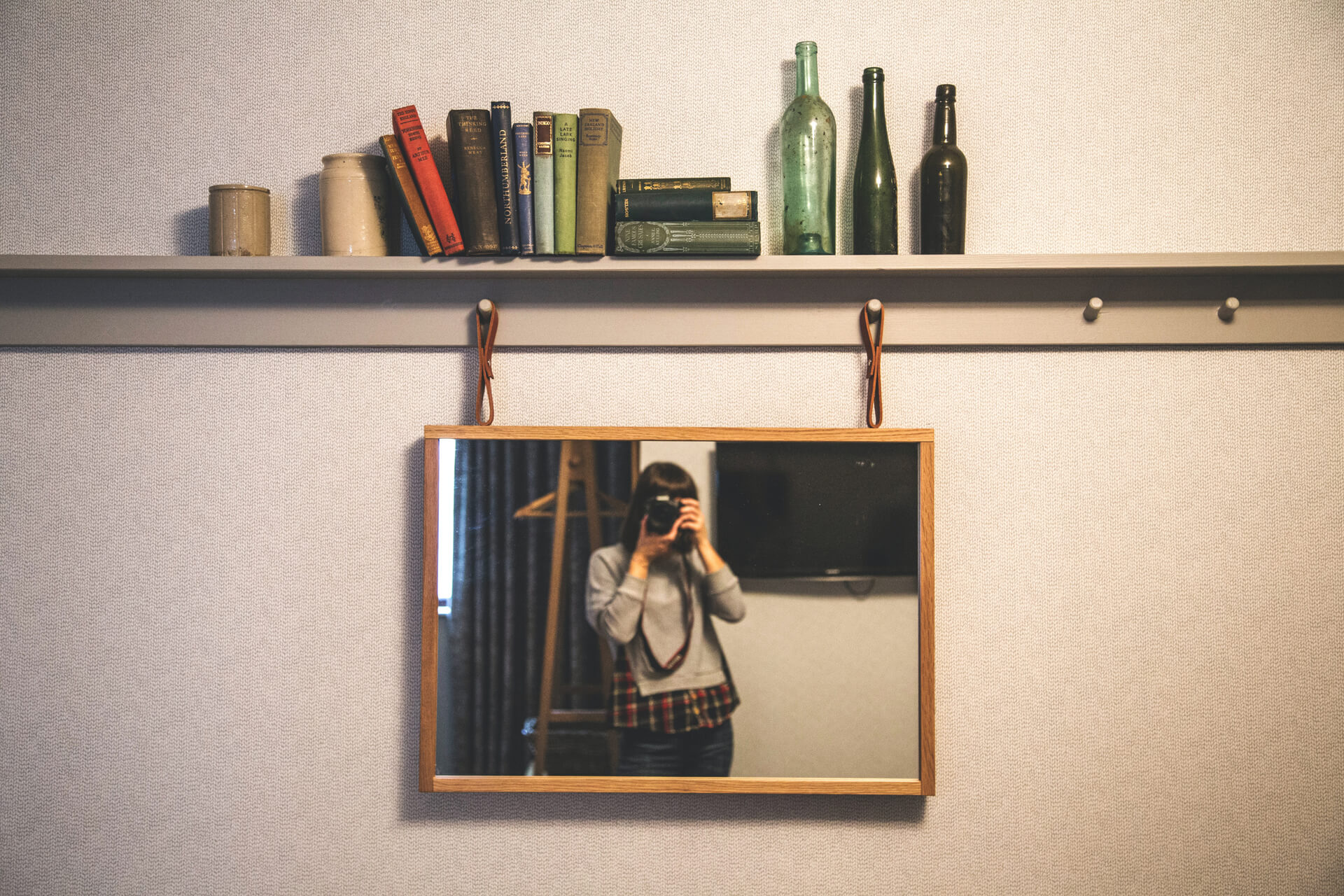 A picture containing indoor, mirror, photo, small              Description automatically generated